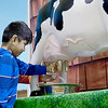 Kevin Harvison | Staff photo<br /> Pictured left, Pittsburg County 4-H Secretary Rhyanne Soliday gives a lesson on how to mikl a cow to Will Rogers Elementary student Christopher Avendano during the OSU Extension Office Farm to You experience.