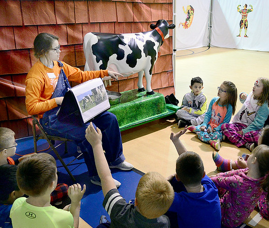 Kevin Harvison | Staff photo<br /> Pictured left, Pittsburg County 4-H Secretary Rhyanne Soliday gives a lesson on dairy to Will Rogers Elementary students. Soliday's dairy lesson was on of many lessons during the OSU Extension Office Farm to You experience.