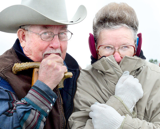 Pictured from left, Jerry Sparks and Carolyn Sparks hurry to get into their vehicle Monday morning after a cold front had hit the McAlester area.