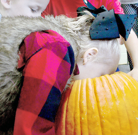 KEVIN HARVISON | Staff photo<br /> Nikoha Ferrari gets up close and personal with the inside of a pumpkin.