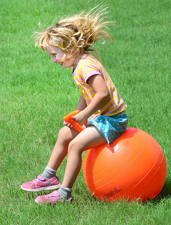 "KEVIN HARVISON | Staff photo<br /> Abby Seamon is ""on the ball"" when it comes to enjoying the nice weather outside."
