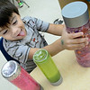 KEVIN HARVISON | Staff photo<br /> Washington Early Chidhood Center student Ezekiel Ponce thinks about which sensory bottle he likes the best.