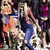 "KEVIN HARVISON | Staff photo<br /> McAlester High School Pom Squad members dressed up in their Halloween Costumes during the away game at Glenpool Friday. Brooke Mills, ""zombie cowgirl"" rides Taylor Boatright, ""cow"" as the two play around before the start of the game."