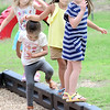 KEVIN HARVISON | Staff photo<br /> Kenna Skimbo, far right, looks for the next place to go during a recent game of playground follow the leader.