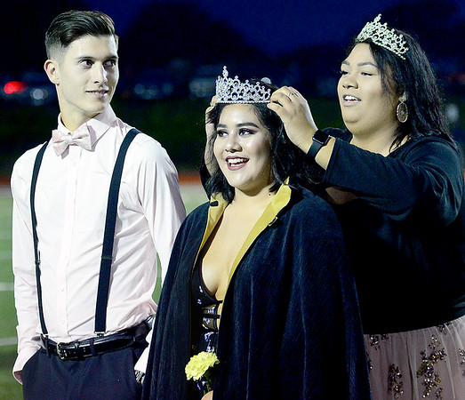 KEVIN HARVISON | Staff photo<br /> Pictured center, Micayla Walker is crowned the 2018 MHS Homecoming Queen by last years queen, Cheyenne Hearst, right as Walker's escort Cody Norris, left, looks on.