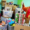 KEVIN HARVISON | Staff photo<br /> Emerson Elementary Employee, Alexia Self prepares to start working on the Emerson Christmas Store. Emerson students have an opportunity to buy gifts for friends and family and can earn and spend store currency with Buff Bucks, Character Coins or by donating to the store. Volunteers wrap and tag the gifts chosen by the students.