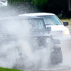 KEVIN HARVISON | Staff photo<br /> A jeep peppers the air with water drops as it drives down Wyndotte Avenue from Strong Boulevard Tuesday morning.