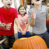 "KEVIN HARVISON | Staff photo<br /> Emerson Elementary students react after the ""lid"" was removed from the pumpkin before the class begins a hands on lesson about pumpkins."