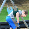 KEVIN HARVISON | Staff photo<br /> Bentley Davis enjoys the weather while hanging around on a swing.