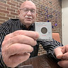 ADRIAN O'HANLON III | Staff photo<br /> Gary Parsons holds a civil war-era coin that will be among military current on display at this week's coin show at the Expo Center.