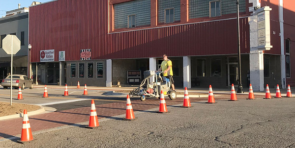 KEVIN HARVISON   Staff photo<br /> Choctaw Avenue was given new crosswalk paint Wednesday morning.