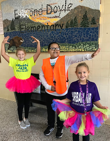 KEVIN HARVISON | Staff photo<br /> Edmond Doyle students have fun sporting their neon colors during Red Ribbon Week. Pictured from left are, Bella Sherwood, Sirr Ellis and Alivia Sherwood.