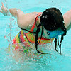 KEVIN HARVISON | Staff photo<br /> Hope Wilbor looks around the bottom of the pool as she beats the heat  in the Chadick Park wadding pool.