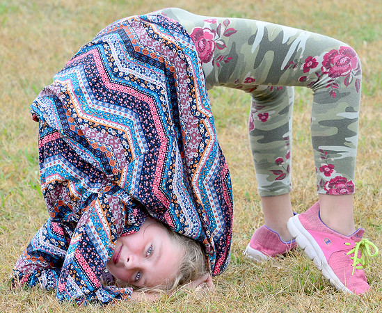 KEVIN HARVISON | Staff photo<br /> Emma Garr poses for the camera while bending and rolling herself around outside Tuesday.