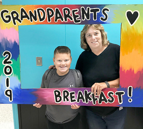 KEVIN HARVISON   Staff photo<br /> Pictured from left, Jackson Miller and his grand mother Janai Miller, pose for a photo before the start of the 2019 Parker Middle School Grand Parents Breakfast Thursday morning.