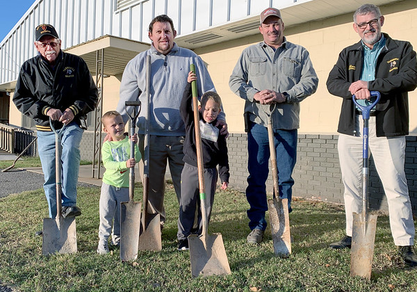 ADRIAN O'HANLON III | Staff photo<br /> Tannehill Public Schools officials and students broke ground Wednesday on the site of a new building for classrooms/safe rooms. Pictured from left, Tannehill Board President Dave Cuenod, Kersh Roberts, Tannehill Principal Jonathan Booth, black hoodie Kindergartener Easton O'Dell, Tannehill board member John Perry and Tannehill Superintendent John Wilcox.