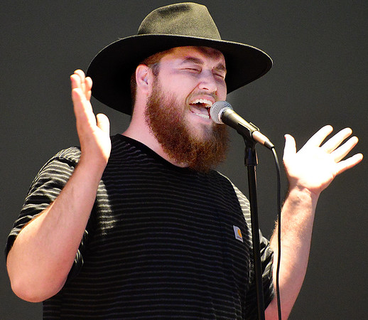 KEVIN HARVISON | Staff photo<br /> Trevor McBane, left, sings during the Annual Pink Ribbon Luncheon held in McAlester Thursday.