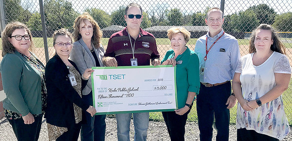 KEVIN HARVISON | Staff photo<br /> Krebs Public School received a big check from the TSET Oklahoma, Healthy Incentive Living. Pictured from left are, Linda Callaway, Angela White, Julie Bisbee, Patrick Turner, Sharon Howard, Rick Westbrook and Michelle Marston.
