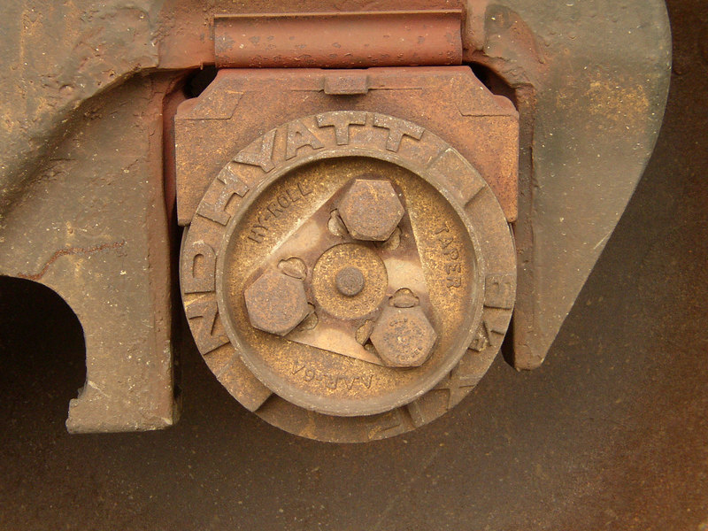 A close-up of the hub on a freight tain wheel.