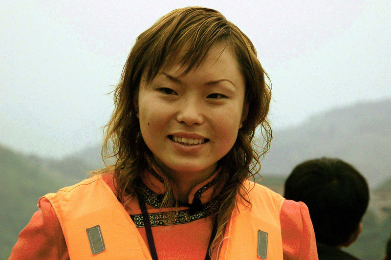chinese guide in boat on yangtze