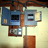 old fuse boxes needed to be replaced by one new circuit breaker box.