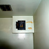 old electric on rec room side, now a junction box for the new electric box