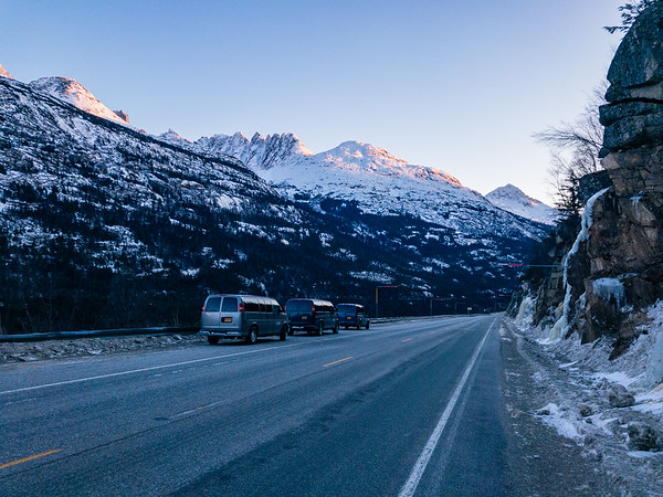 Three UAS vans parked on the side of Klondike Highway as we climbed the mountain side above the road.