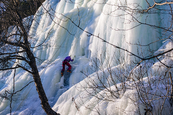"""Climber reaches different slope angle on ice wall at the """"Amphitheater""""."""