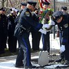 Kelsey Leyva — The Morning Journal <br> Members of the Elyria Police Department Honor Guard on March 15 place a memorial wreath near the memorial stone for police Sgt. James A. Kerstetter during a Memorial Service at the Elyria Police Department, 18 West Ave. Kerstetter was shot and killed in the line of duty on March 15, 2010.