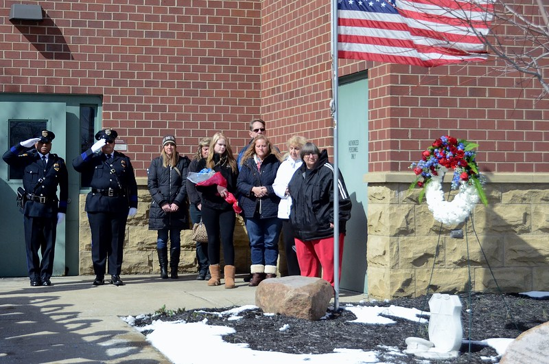 Kelsey Leyva — The Morning Journal <br> Members of the Kerstetter family stand with members of the Elyria Police Department's Honor Guard after a memorial wreath is placed on the memorial stone commemorating Elyria police Sgt. James. A. Kerstetter who was killed int he line of duty March 15, 2010. A Memorial Service was held March 15 at the Elyria Police Department, 18 West Ave.