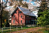 Red Farmhouse Near Covered Bridge Road