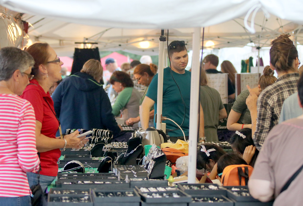 . Jonathan Tressler - The News-Herald. Artisans, vendors, browsers and buyers mingle beneath one of the vendor tents on the west side of Classic Park in Eastlake Aug. 11 during the 2017 Ohio Celtic Festival�s kickoff.