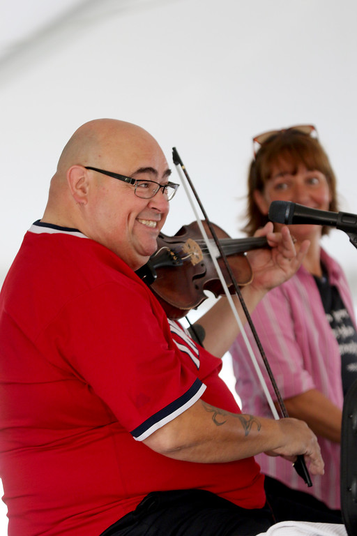 . Jonathan Tressler - The News-Herald. Paul Baker of Brigid�s Cross plays dueling violins with himself as wife and fellow musician Peggy Goonan-Baker eggs him on in the background Aug. 11 at the 2017 Ohio Celtic Festival at Classic Park in Eastlake.
