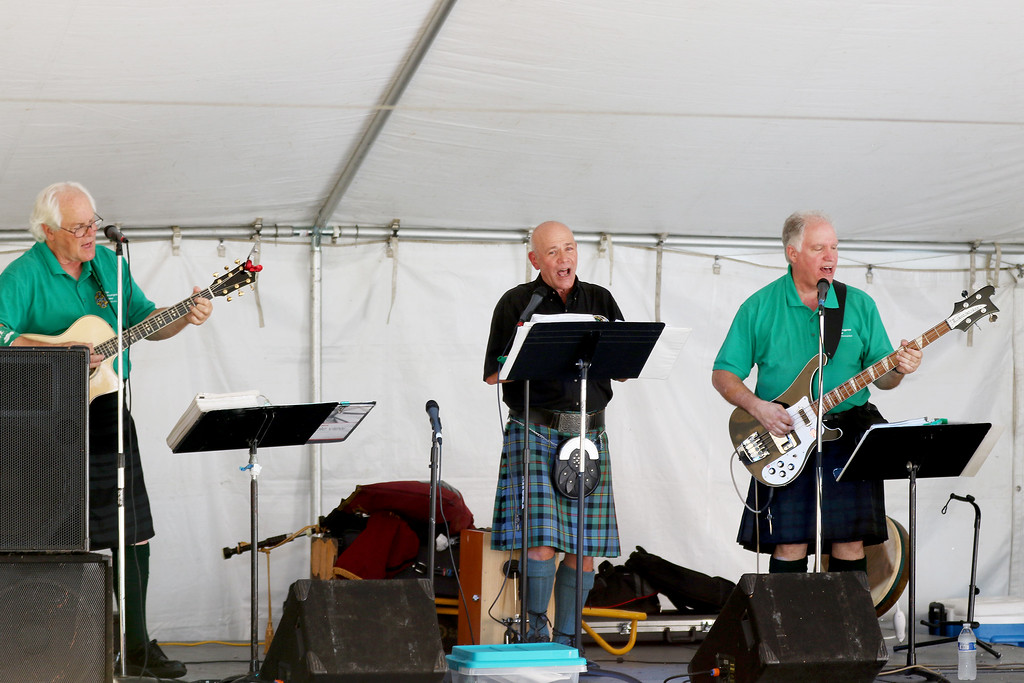 . Jonathan Tressler - The News-Herald. Members of No STrangers Here, from left, Pat Haynes, Larry Bachtel and Bob Crawford perform durin gthe first few hours of the 2017 Ohio Celtic Festival Aug. 11 at Classic Park in Eastlake.