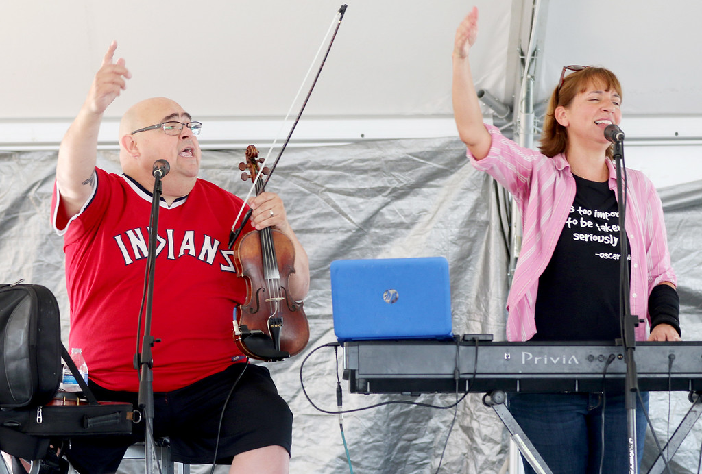 . Jonathan Tressler - The news-Herald. Paul Baker, left, and Peggy Goonan-Baker, who perform as Brigid�s Cross, get the crowd riled up Aug. 11 from the Miller Stage during the kickoff of the 2017 Ohio Celtic Festival.