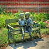 Reading Lesson...copper sculpture sitting in front of the Spencerville Library.