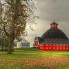 This round barn is located in the Indian Lake Region of northwest central Ohio. It is part of the Maple Avenue Farm which was owned by J.H.Manchester. The barn was built in 1908 by Horace Duncan.