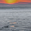Ice slabs as seen from the Coast Guard station at sunset.  A lot of seagulls on the ice and in the air.