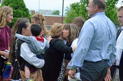 Leah McDonald - Oneida Daily Dispatch Lorraine Fargo, center, hugs Oneida High School Z Club advisor Patty Vaccaro following a ceremony in honor of her husband, custodian Ron Fargo, on Tuesday, May 30, 2017. Ron Fargo died in 2016.