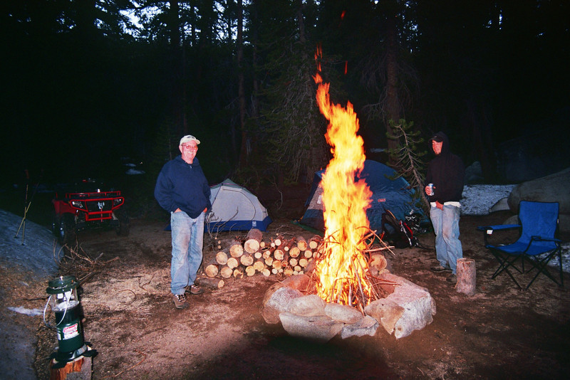 2 Dudes next to The Big Fire, One Dude grab'n his Balls jpg
