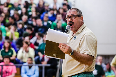 Principal Ted Moccia addresses the crown at last Friday's pep rally to celebrate both the academic and athletic winter season accomplishments.