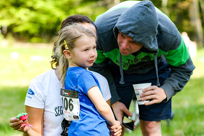Despite just completing in the Aspire Higher Race for Education Mini-Challenge, Jayne Rowles needs consoling by her father Eric  and step-mother Anne Ajayi (hidden) who is holding the post-race cupcake. The event was held at Roberts Farm and Preseve in Norway.