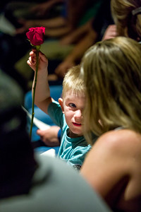 Eric Charbonneau, son of Nancy Charbonneau, plays with a rose given to his aunt Stacy Blaquiere by his cousin Hannah Blaquiere during the CNA graduation ceremonies held at Oxford Hills Comprehensive High School Wednesday.