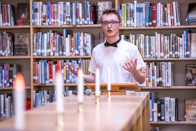 Conor Beauchesne, as sophomore at Oxford Hills Comprehensive High School, reads a poem in the school's library during a poetry slam event held by his English class.