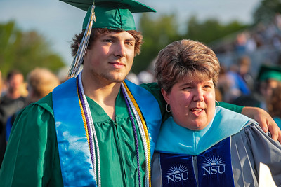 Ryland VanDecker, left, poses with one of his teachers, Wendy Robichaud.