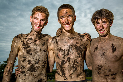 """All Smiles: OHCHS cross country teammates Zane Dustin, Logan Hallee and Nate McNutt pose after the 10th annual """"Muddy Bloody."""" The event occurs in a top secret location in Norway and involves running through, well, mud."""