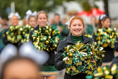 Viking cheerleader Isabella Iadarola participates in the parade with the rest of her teammates.