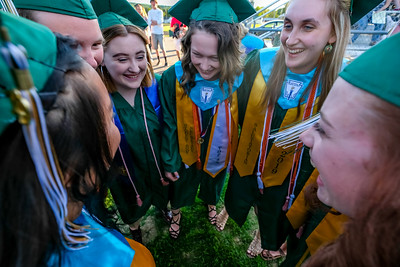 Annie Choi, Jadah Adams, Haley Allaire, Saige McGinnis, Kristina Wilson and Elizabeth Sanborn huddle before marching into the ceremony.