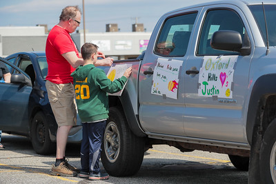 Ryan Smith and his father mark decorate their truck before the parade.