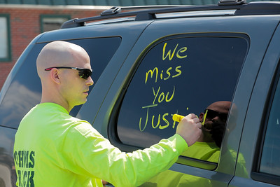 Daryll Rugg of South Paris writes a greeting on his truck's window in preparation for the parade.
